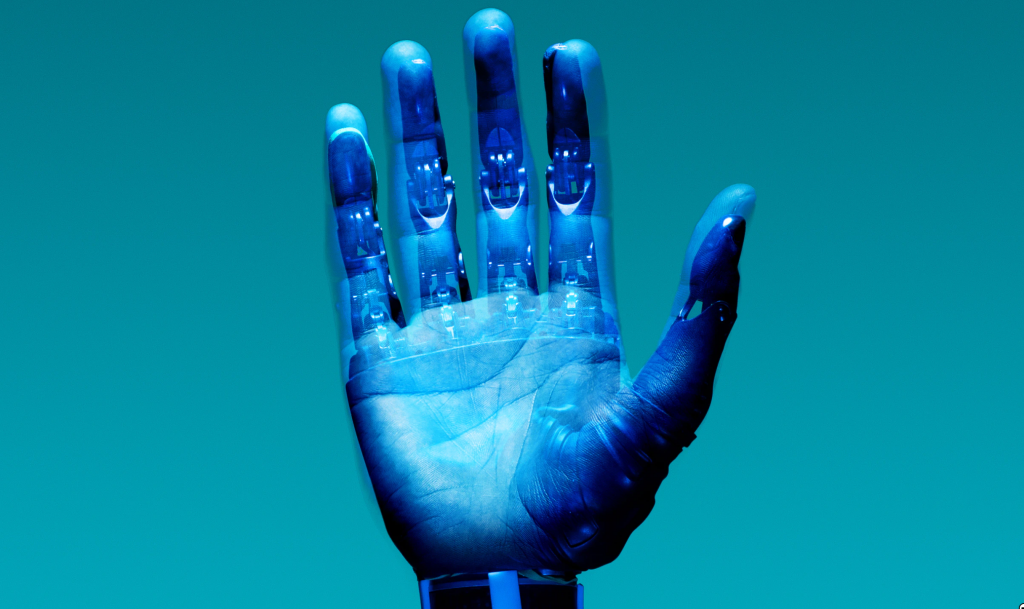 a human hand with a robot exoskeleton overlaid