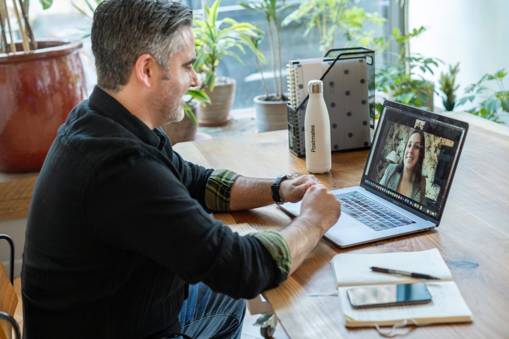 a man in a sweater on a video call
