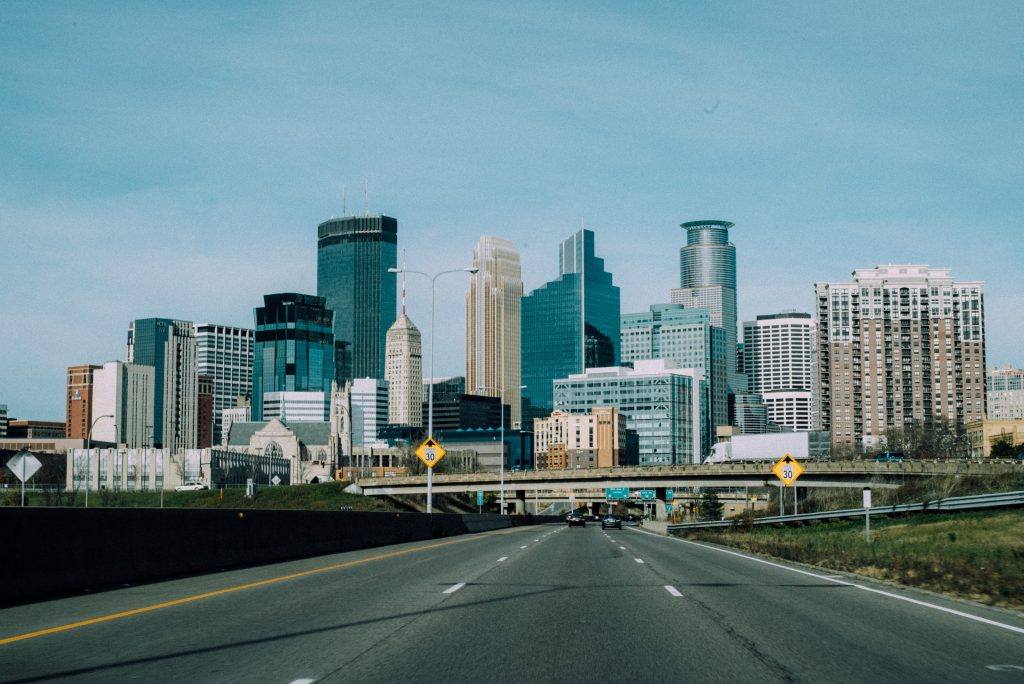 the skyline of minneapolis viewed from the interstate