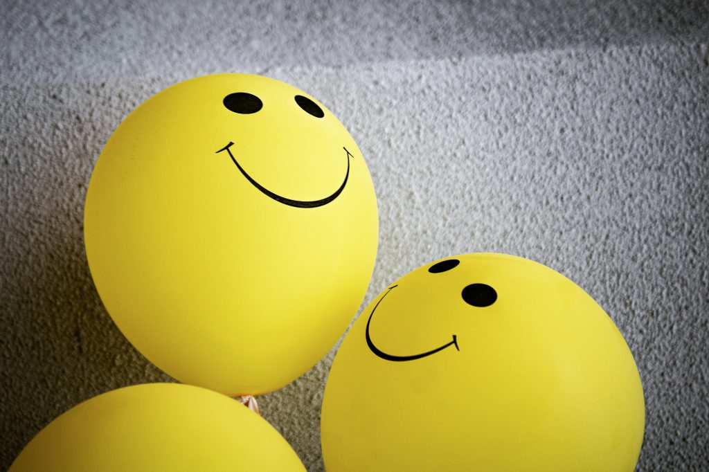 smiling faces on balloons